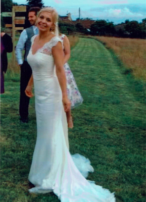 Charlie wore a bespoke gown by Sheila Harding London complimented with a lace bolero for her Autumn 2016 Wedding.